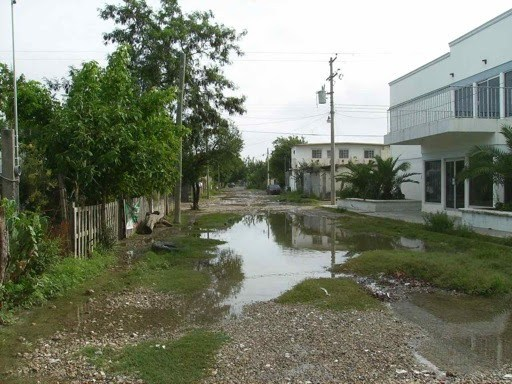 Damage to the street outside the clinic in Reynosa from Hurricane Alex