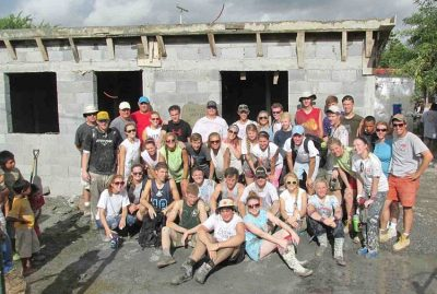 A team from Charlotte after pouring a roof in Mexico