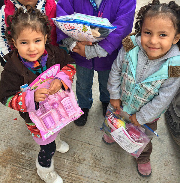 Kids excited with their gifts at the Christmas fiesta in Mexico