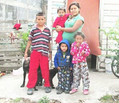 A family waiting for a house in Mexico