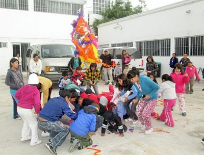 Kids enjoying a pinata at the Christmas fiestas in Reynosa