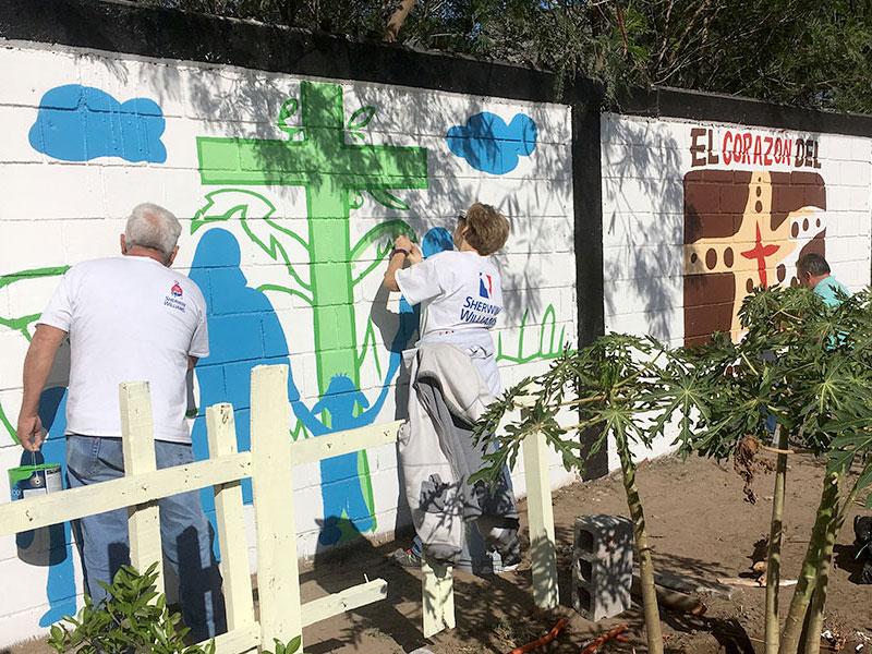 Painting murals in Naranjito