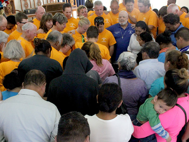A special time of prayer at a dedication service in Reynosa