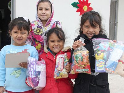 Kids in Miguel Aleman with their toys and candy at the Christmas fiesta