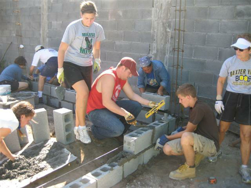 A group working to build a house in Mexico