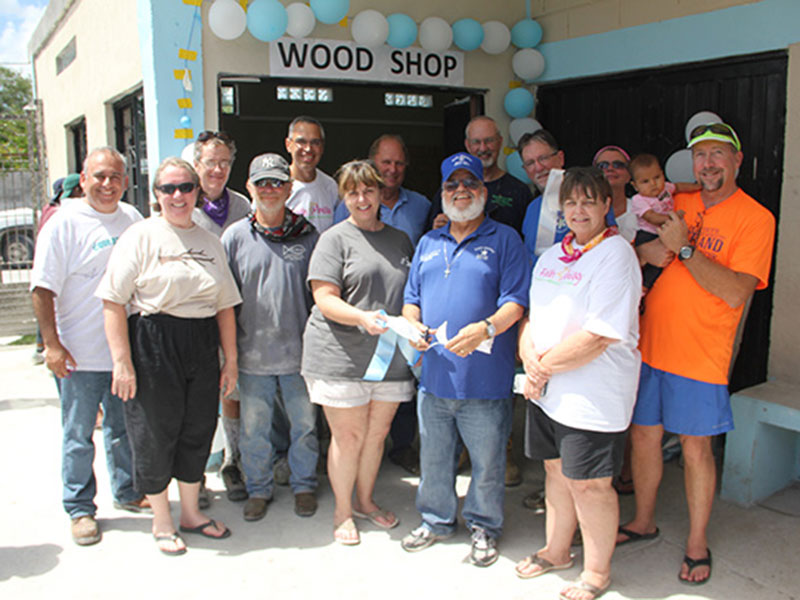 The Board of Directors officially opening the woodworking shop in Reynosa