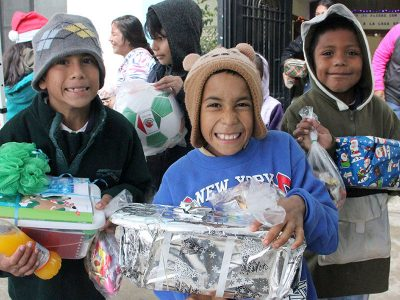 Kids with their new toys at the Christmas fiesta in Reynosa