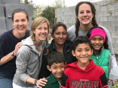 Colleen her mom and her sister with a family they helped build a home for in Reynosa